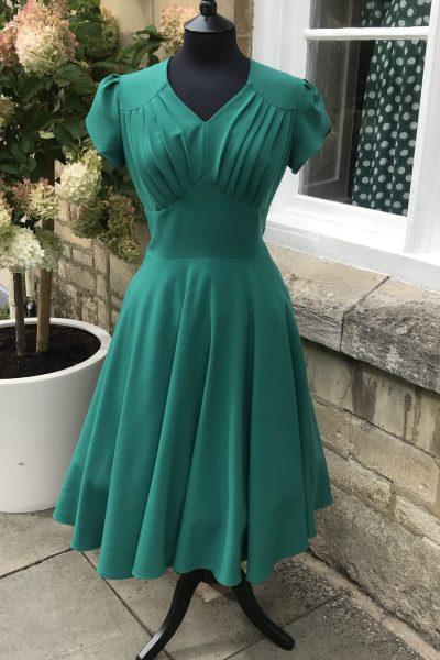 emerald green swing dress