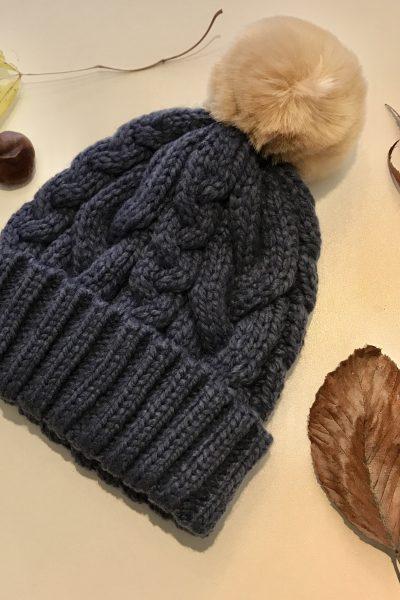 Navy blue cable knit bobble hat