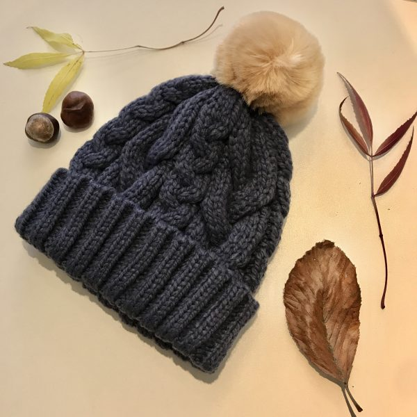 Navy blue cable knit bobble hat