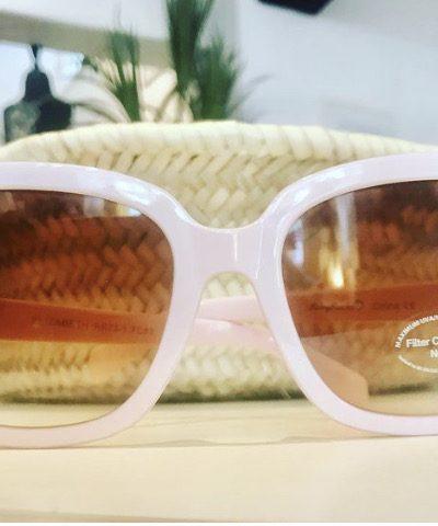 big pink framed glasses